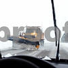 Rob Winner – rwinner@daily-chronicle.com<br /> A snow plow truck removes snow from Somonauk Road while traveling south towards Hinckley in DeKalb county on Wednesday December 9, 2009.