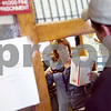 "Beck Diefenbach – bdiefenbach@daily-chronicle.com<br /> <br /> Post Office Clerk Karen Phillips scans a package for John Gilberth, of Waterman, at the Waterman Post Office in Waterman, Ill., on Tuesday March 10, 2009. Delivery service may be cut from six days to five in hopes of reduced spending. ""It's fine with me,"" said Gilberth concerning the possible canceling of one day of delivery service."