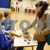 Rob Winner – rwinner@daily-chronicle.com<br /> (From left to right) Kelly Marshall and Brianna Kramer collect a donation for a button from classmate Rebecca Whittenhall before the start of classes at Genoa-Kingston Middle School on Wednesday morning. The buttons were made to help raise money for the family of Ashley Kim, a fellow student, who became paralyzed from the waist down after a swimming accident on September 12, 2009.<br /> 09/30/2009<br /> Kelly Marshall 13, 8th grade<br /> Brianna Kramer 13, 8th grade<br /> Rebecca Whittenhall 14, 8th grade