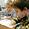 Rob Winner – rwinner@daily-chronicle.com<br /> <br /> Third grade students Carter Novak (front) and Christopher Kleba read aloud during a reading lesson at Kingston Elementary School on October 8, 2009.