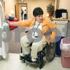 Beck Diefenbach  -  bdiefenbach@daily-chronicle.com<br /> <br /> Emily Lampkin grabs the ranch dressing from the refrigerator as she helps to prepare lunch for her class at Life School Transition Program in Sycamore, Ill., on Tuesday Feb. 10, 2009. Lampkin is learning to provide for herself in practice such as cooking a meal.