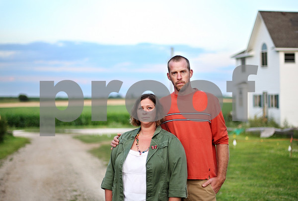 Beck Diefenbach  -  bdiefenbach@daily-chronicle.com<br /> <br /> Jeremy and Catie Roller pose by the road which has been taken from their property after a lengthly lawsuit with their township.