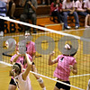 Rob Winner –  rwinner@daily-chronicle.com<br /> Sycamore's Brittany Olson (4) watches her tipped ball go over the net and past DeKalb's Rachel Raynor during the third game for a point. Sycamore defeated DeKalb 2-1.<br /> 09/22/2009