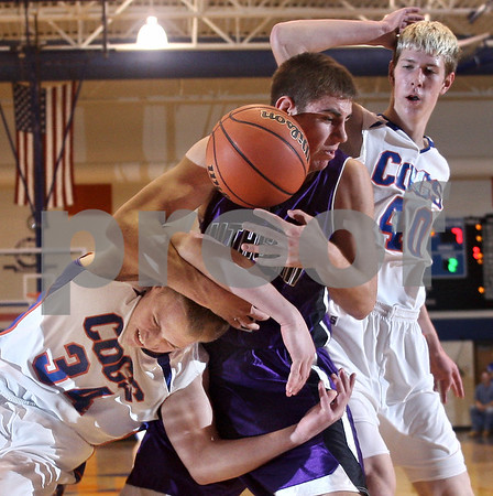 Beck Diefenbach  -  bdiefenbach@daily-chronicle.com<br /> <br /> Genoa-Kingston forward Cameron Kamp (34) and Rockford Lutheran guard Brad Schrom (4) battle for a rebound during the first quarter of the game at GK in Genoa, Ill., on Friday Jan. 16, 2009. Lutheran beat GK 46 to 39.