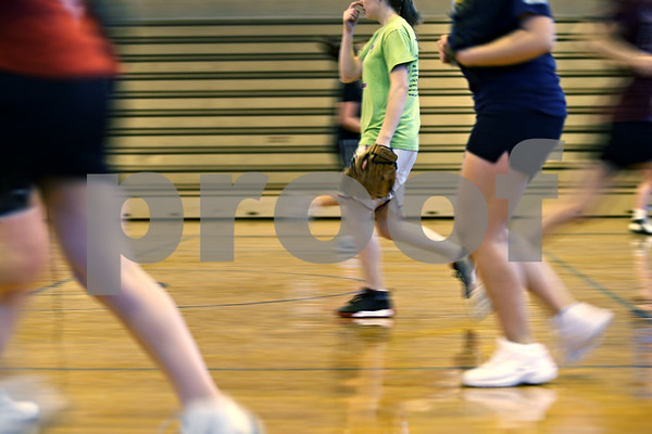 Beck Diefenbach – bdiefenbach@daily-chronicle.com<br /> <br /> Indian Creek girls rush across the floor during practice at the Indian Creek Middle School gymnasium in Waterman, Ill., on Wednesday March 11, 2009.