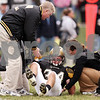 Beck Diefenbach  -  bdiefenbach@daily-chronicle.com<br /> <br /> Sycamore linebacker Steve Nayman (34) is helped off the field during the third quarter of the playoff game against Montini at Sycamore High School in Sycamore, Ill., on Saturday Nov. 14, 2009. Nayman was later taken away from field on a stretcher in an ambulance.