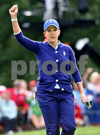 Rob Winner rwinner@shawsuburban.com<br /> Cristie Kerr raises her arm after winning the fourth hole with a birdie for the USA team during the first round of the Solheim Cup.<br /> 08/21/2009