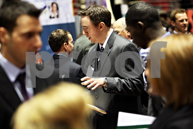 Beck Diefenbach – bdiefenbach@daily-chronicle.com<br /> <br /> David Money speaks with recruiters from Aldi Grocers at the job fair at the Northern Illinois University Convocation Center in DeKalb, Ill., on Wednesday Feb. 25, 2009.