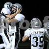 Rob Winner –  rwinner@daily-chronicle.com<br /> After his touchdown reception, Kaneland's Quinn Buschbacher (left) is greeted with a hug from teammate Ryley Bailey in the second quarter of Friday night's game in Sycamore.<br /> 09/18/2009