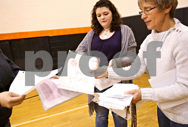 """Beck Diefenbach  -  bdiefenbach@daily-chronicle.com<br /> <br /> Teacher Cindy Lofthouse, right, and junior Colleen Boyce, collect """"thank you"""" letters written by students for soldiers currently serving in the military, during class at DeKalb High School in DeKalb, Ill., on Thursday Nov. 5, 2009. Colleen and her brother are collecting Halloween candy and writing letters to be sent to troops serving in the Middle East."""