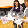 "Beck Diefenbach  -  bdiefenbach@daily-chronicle.com<br /> <br /> Teacher Cindy Lofthouse, right, and junior Colleen Boyce, collect ""thank you"" letters written by students for soldiers currently serving in the military, during class at DeKalb High School in DeKalb, Ill., on Thursday Nov. 5, 2009. Colleen and her brother are collecting Halloween candy and writing letters to be sent to troops serving in the Middle East."