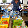 Rob Winner – rwinner@daily-chronicle.com<br /> Dana Rourke, a second grade teacher at Lincoln Elementary School in DeKalb, sorts books for the upcoming school year on Tuesday afternoon.<br /> 08/11/2009