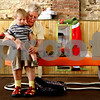 Rob Winner – rwinner@daily-chronicle.com<br /> Michael Anderson, 1, of Sycamore, tries on new footwear with help from his grandmother, Sandy Anderson, at Stomp in Sycamore on Wednesday afternoon. Stomp is a new shoe store wrapping up its first month in the location that housed family-owned Downtown Shoes for 50 years.<br /> 07/28/2009