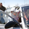 Beck Diefenbach  -  bdiefenbach@daily-chronicle.com<br /> <br /> Center, Scott Pumroy, director of the DeKalb County Soil and Water Conservator District, attempts to fit a rain water collection barrel into Cason Snow's (left) car, who was picking up his rain and compost barrels at the DeKalb County Farm Bureau in Sycamore, Ill., on Friday April 17, 2009.