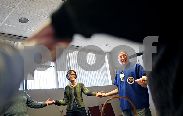Beck Diefenbach – bdiefenbach@daily-chronicle.com<br /> <br /> Volunteer hospice worker Jack Case, right, participates in a movement exercise during an in-service meeting for hospice volunteers at the DeKalb County Hospice building in DeKalb, Ill., on Thursday Feb. 5, 2009.