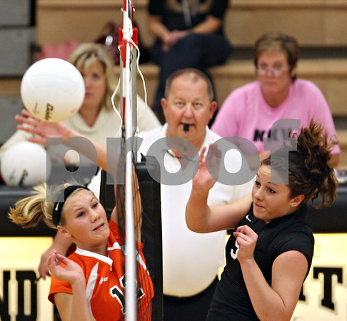Beck Diefenbach – bdiefenbach@daily-chronicle.com<br /> <br /> DeKalb's Courtney Thomas (left, 12) can't stop a shot by Kaneland's Jessica Lubic (9) during the first period of the game at Kaneland High School in Maple Park, Ill., on Saturday Sept. 19, 2009.