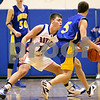 Beck Diefenbach  -  bdiefenbach@daily-chronicle.com<br /> <br /> Hinckley Big-Rock's Ryan Salazar (14) attempts to steal the ball from Somonauk's Nick Gottlieb (5) during the first quarter of the game at HBR High School in Hinckley, Ill., on Tuesday Jan.. 20, 2009. Somonauk beat HBR 80 to 67.