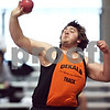 Beck Diefenbach  -  bdiefenbach@daily-chronicle.com<br /> <br /> DeKalb's Dan Parson throws the shot put during the Western Sun Conference Invitational track and field meet at Sycamore High School in Sycamore, Ill., on Thursday March 19, 2009.