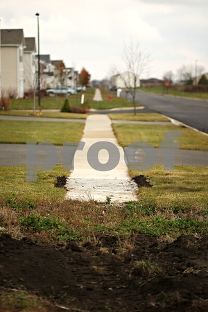 Beck Diefenbach  -  bdiefenbach@daily-chronicle.com<br /> <br /> A sidewalk ends abruptly in the Greenfield Ridge subdivision in Waterman, Ill., on Wednesday Nov. 18, 2009.