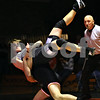 Beck Diefenbach  -  bdiefenbach@daily-chronicle.com<br /> <br /> Kaneland's Zack Ganz (top) is thrown to the ground by DeKalb's Devon Walker during the 189-pound match at DeKalb High School in DeKalb, Ill., on Friday Dec. 11, 2009.