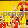 Beck Diefenbach  -  bdiefenbach@daily-chronicle.com<br /> <br /> DeKalb's Rachel Raynor (7, left) and Emily Bemis (11) watch as they miss a block during the third period of the game against Sycamore at Sycamore High School in Sycamore, Ill., on Thursday Oct. 15, 2009.