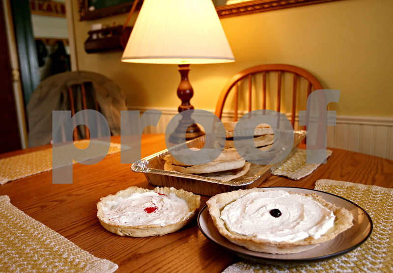 Beck Diefenbach  -  bdiefenbach@daily-chronicle.com<br /> <br /> Varies pies sit ready for throwing in Molly Holbrook's kitchen in Genoa, Ill., on Friday June 5, 2009. Holbrook plans on making 100 pies to set the record of the largest pie fight on their farm on Saturday June 13.