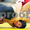 Beck Diefenbach  -  bdiefenbach@daily-chronicle.com<br /> <br /> Sycamore's Austin Zimmer is nearly taken down by Yorkville's Conner Bass during the 112 lbs match of the game at Sycamore, Ill., on Thursday Dec. 3, 2009.