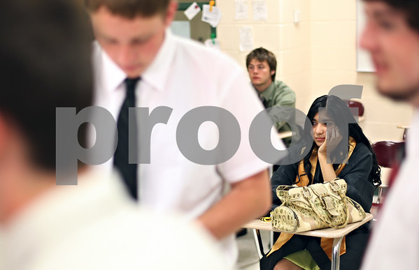 Beck Diefenbach  -  bdiefenbach@daily-chronicle.com<br /> <br /> Anna Aguilera waits in her classroom before the Sycamore graduating ceremony at Sycamore High School in Sycamore, Ill., on Sunday May 31, 2009.
