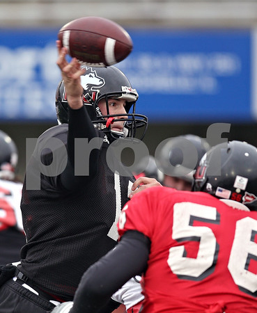 Beck Diefenbach  -  bdiefenbach@daily-chronicle.com<br /> <br /> Northern Illinois quarterback Chandler Harnish (12) during practice at Huskie Stadium in DeKalb, Ill., on Tuesday April 14, 2009.