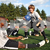 Rob Winner – rwinner@daily-chronicle.com<br /> Eric Ngum (left), 12, and Robby Bishop, 12, both of DeKalb, react during a game at a recent practice for the Northern Illinois Football Club.<br /> 08/05/2009