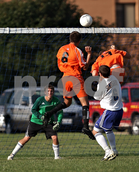 Beck Diefenbach  -  bdiefenbach@daily-chronicle.com<br /> <br /> Somonauk goal keeper Eric Green watches as DeKalb's Joe Ferguson (8) and Pat Rouke (13) attempt to head the ball during the first half of the game at Somonauk High School in Somonauk, Ill., on Monday Sept. 14, 2009. DeKalb beat Somonauk 2-0.