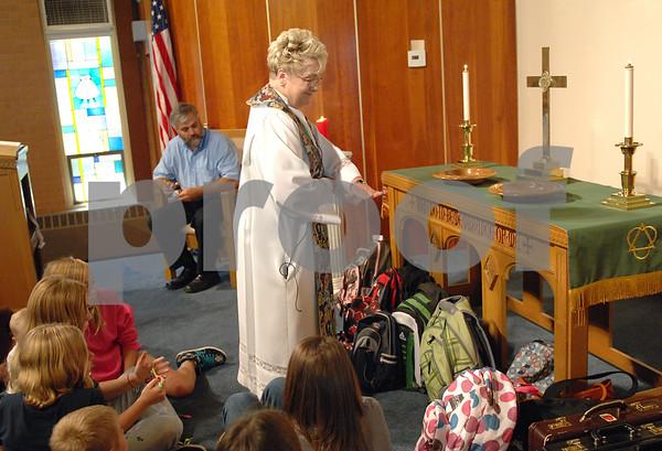Pastor Sandra Graber blesses a group of children's backbacks during the Blessing of the Backbacks at the Waterman Presbyterian Church on Sunday, September 13, 2009 in Waterman.(Marcelle Bright/for the Chronicle)