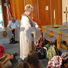 Pastor Sandra Graber blesses a group of children's backbacks during the Blessing of the Backbacks at the Waterman Presbyterian Church on Sunday, September 13, 2009 in Waterman.(Marcelle Bright/for the Chronicle)