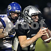Beck Diefenbach  -  bdiefenbach@daily-chronicle.com<br /> <br /> Kaneland quarterback Joe Camiliere (12, right) is followed by Geneva defensive lineman Andrew Mariotti (5) before he is sacked during during the second quarter of the game at Kaneland High School in Maple Park, Ill., on Friday Oct. 16, 2009.