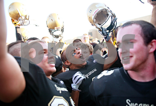 Beck Diefenbach  -  bdiefenbach@daily-chronicle.com<br /> <br /> Sycamore's Marckie Hayes (center) leads his team in cheers after defeating Wheaton Academy 42 to 0 at Sycamore High School in Sycamore, Ill., on Saturday Nov. 7, 2009.