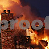 Beck Diefenbach  -  bdiefenbach@daily-chronicle.com<br /> <br /> DeKalb and Sycamore firefighters battle a fire at 1563 W Stonehenge Dr. Sycamore, Ill., on Wednesday Jan. 7, 2009.