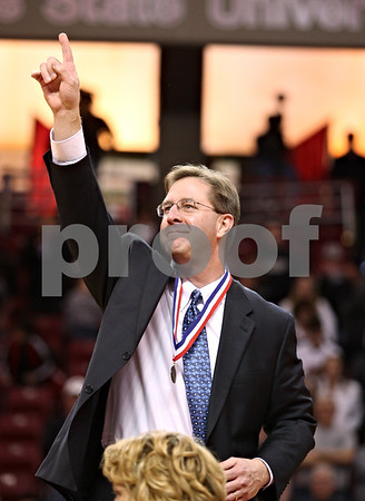 Beck Diefenbach – bdiefenbach@daily-chronicle.com<br /> <br /> Hinckley-Big Rock's assistant coach Don Rasich celebrates after receiving his medal for defeating Winchester West Central in the Class 1A State Championship at the Redbird Arena in Normal, Ill., on Saturday Feb. 28, 2009.