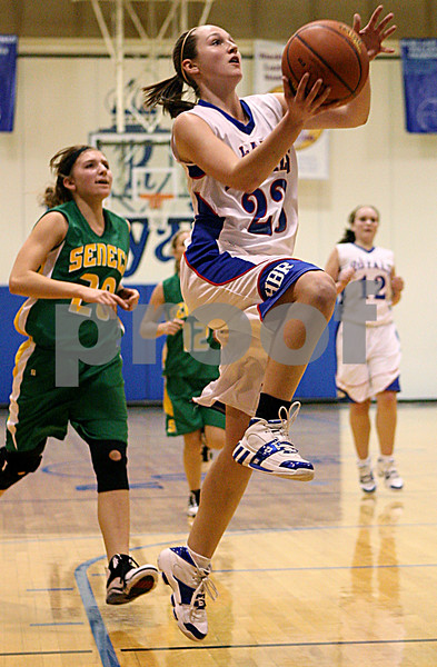 Rob Winner – rwinner@daily-chronicle.com<br /> Just before time expires in the first half, Alyssa Baunach, of Hinckley-Big Rock puts up two after a Seneca turnover during Saturday night's game in Hinckley, Ill.<br /> 12/19/2009