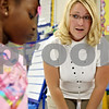 Rob Winner –  rwinner@daily-chronicle.com<br /> Lauren Peckham, a first grade teacher at Tyler Elementary School in DeKalb, listens to Tamiah Griffin's concerns on Wednesday morning.<br /> 09/16/2009