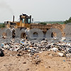 Rob Winner – rwinner@daily-chronicle.com<br /> A compactor rolls over trash at the top of a landfill at the DeKalb County Recycling and Disposal Facility on Tuesday afternoon.<br /> 08/04/2009