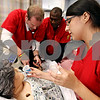 Rob Winner – rwinner@daily-chronicle.com<br /> <br /> As Dan Cwik (from left to right) and Donald Walker check the blood pressure of Maribel, Rose Vargas pretends to administer medication.<br /> <br /> 10/16/2009