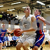 Rob Winner – rwinner@daily-chronicle.com<br /> Rob Winner – rwinner@kcchronicle.com<br /> Kaneland's Dave Dudzinski moves the ball under the basket during the first half while Glenbard South's Pat Childs provides pressure.<br /> 12/01/2009