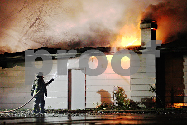 Rob Winner – rwinner@daily-chronicle.com<br /> Sycamore firefighters work to control a blaze at a house located on Maness Court in Sycamore on Tuesday night.<br /> 11/10/2009