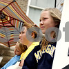Rob Winner – rwinner@daily-chronicle.com<br /> Lilia Edwards (front to back), 12, her cousin, Haley Christian, 14, and Elena Edwards, 10, try to sell lemonade on the  corner of Somonauk and Elm streets in Sycamore on Friday afternoon. Sisters Lilia and Elena Edwards qualified for the Junior Olympic nationals with the Huskie Track Club and are now trying to raise the funds to get there.<br /> 07/17/2009
