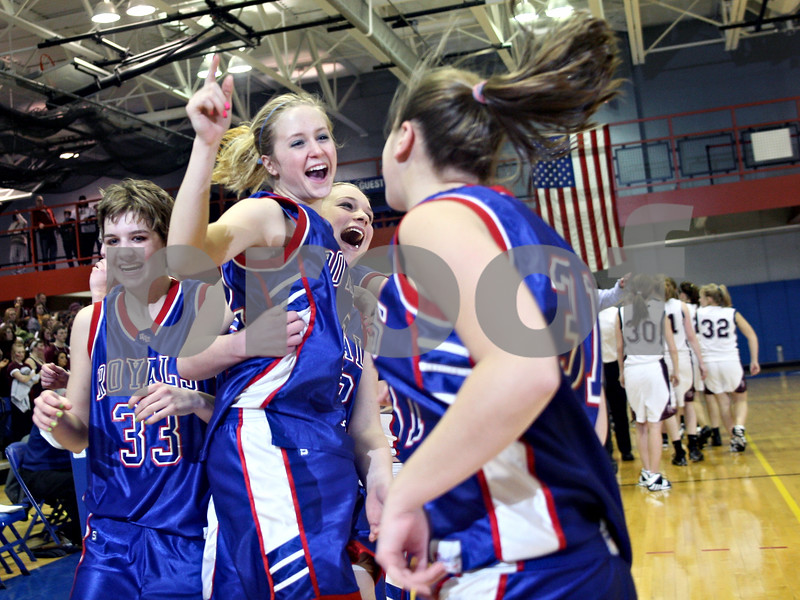 Beck Diefenbach – bdiefenbach@daily-chronicle.com<br /> <br /> Hinckley-Big Rock's Maxzine Rossler(22) celebrates with teammates Tess Godhardt (33) and Bianca Edmeier (31) after beating Dakota High School in the 1A Super Sectional game at Elgin Community College in Elgin, Ill., on Monday Feb. 23, 2009.