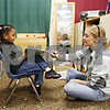 Beck Diefenbach  -  bdiefenbach@daily-chronicle.com<br /> <br /> (Left) Taliah Griffen, 4, and her teacher Kourtney Johnson read along to an audio book during day care at the Children's Learning Center in DeKalb, Ill., on Monday Jan. 26, 2008.