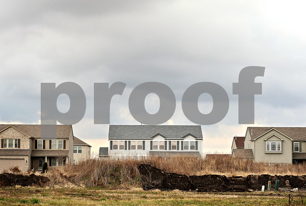 Daily Chronicle file photo<br /> <br /> Piles of dirt left by a developer sit in front of homes in the Greenfield Ridge subdivision in Waterman, Ill., on Wednesday Nov. 18, 2009.