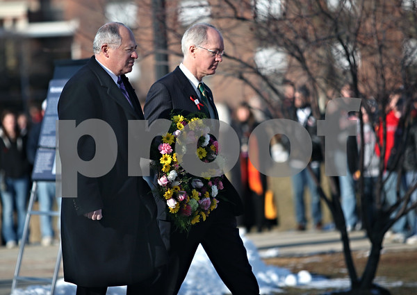 Beck Diefenbach  -  bdiefenbach@daily-chronicle.com<br /> <br /> U.S. Rep. Bill Foster, D-Batavia, and Gov. Pat Quinn present one of the memorial wreaths outside Cole Hall on the campus of Northern Illinois University in DeKalb, Ill., on Saturday Feb. 14, 2009.