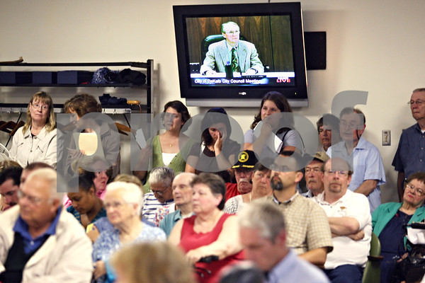 Beck Diefenbach  -  bdiefenbach@daily-chronicle.com<br /> <br /> People listen as DeKalb Mayor Kris Povlsen explains how the open hearing portion of the council meeting will operate at the City Municipal building in deKalb, Ill., on Monday June 8, 2009.