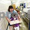 Beck Diefenbach  -  bdiefenbach@daily-chronicle.com<br /> <br /> Hiawatha food service director Angie Moore guides kindergardener Olivia Rostein through a practice lunch line on her first day of school in Kirkland, Ill., on Tuesday Aug. 18, 2009.